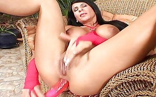 busty brunette fingers her slick pussy and