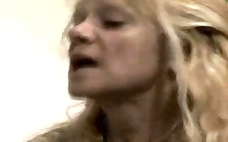 golden-haired granny is eating cock and then she