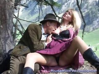 Busty blonde is in the mountains outside blowing