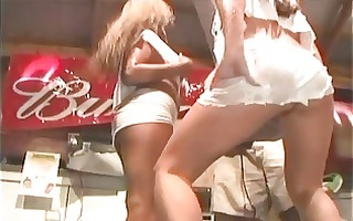 lesbo chicks on the stage dancing while stripping
