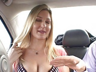 Horny blonde hitchhiker flashing tits and doing