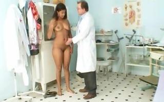 black obese manuela gyno exam by white old doctor