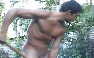 pumped up homosexual dude works in the garden