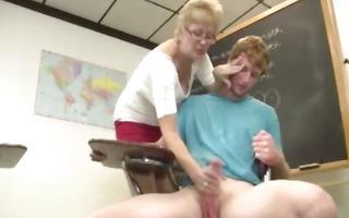 granny teacher tugs her students jock in the