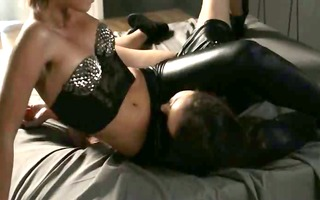 girls in latex sexing with belt on