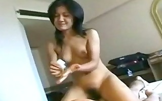 thai angel giving massage riding on guy on the