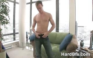 cute chap rubbing his massive jock
