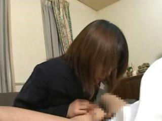 Little Asian schoolgirl gives this guy a handjob