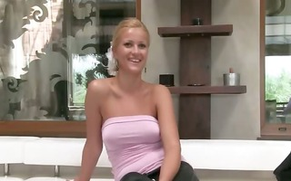 golden-haired enjoying sex on leather sofa