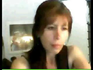 Mexican babe Madurita is watching her webcam as