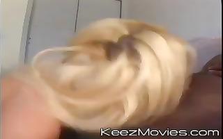 blond chick receives a nice large darksome weenie