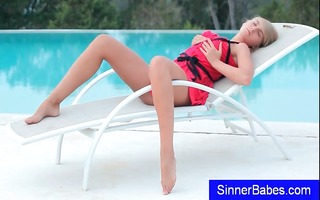 cute little blond teen is by the pool and